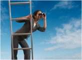 woman leader climbing ladder