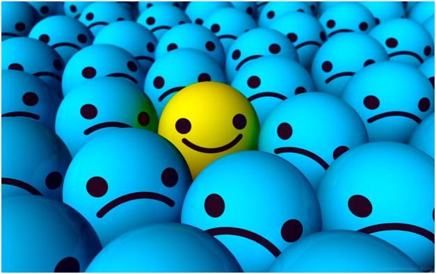 Happy face in sad faces