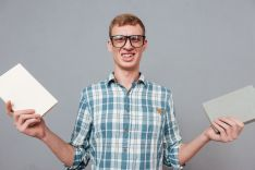 Student in glasses with books