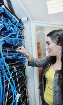 woman it engineer in network server room