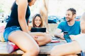 graphicstock-group-of-friends-millennials-sitting-in-pinewood-using-digital-devices-social-addicted-phubbing-technology-concept_rpxae5qYkb